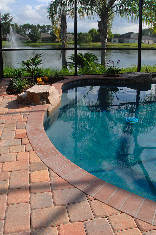Tremron olde towne pool deck pavers and coping for Best pavers for pool deck