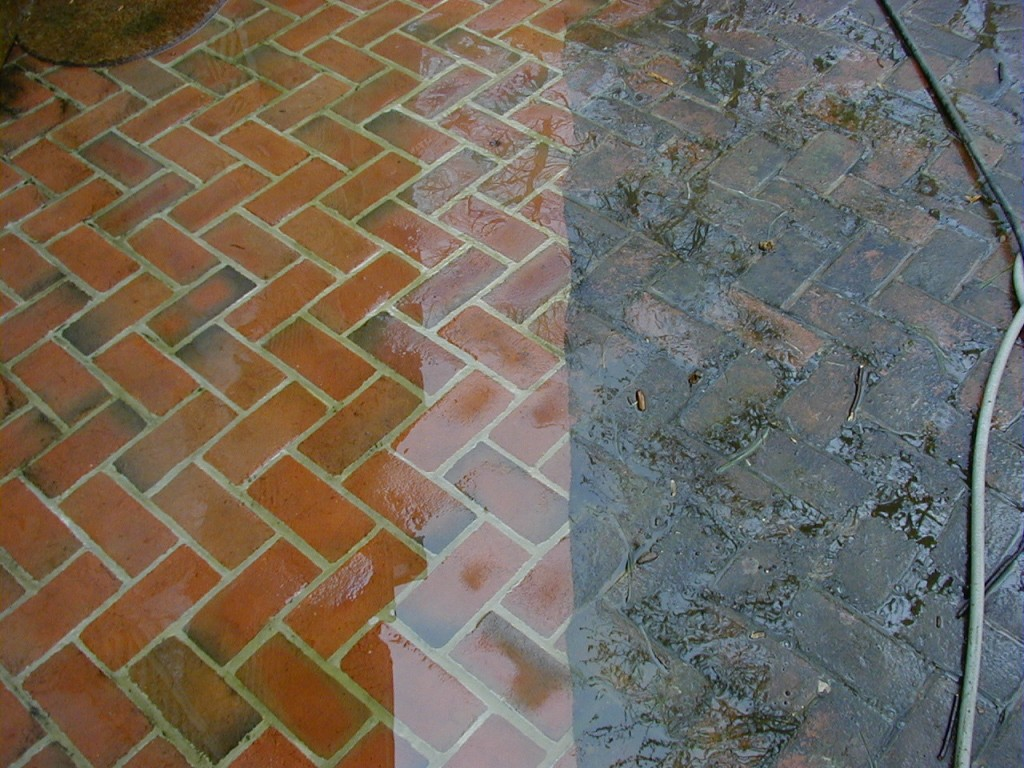 Cleaned and sealed pavers beside dirty unsealed pavers for How to clean dirty concrete