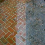cleaned and sealed pavers beside dirty unsealed pavers